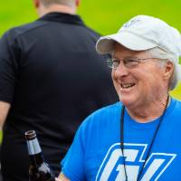A guest holding a beer at the Jamie Hosford Football Center dedication.